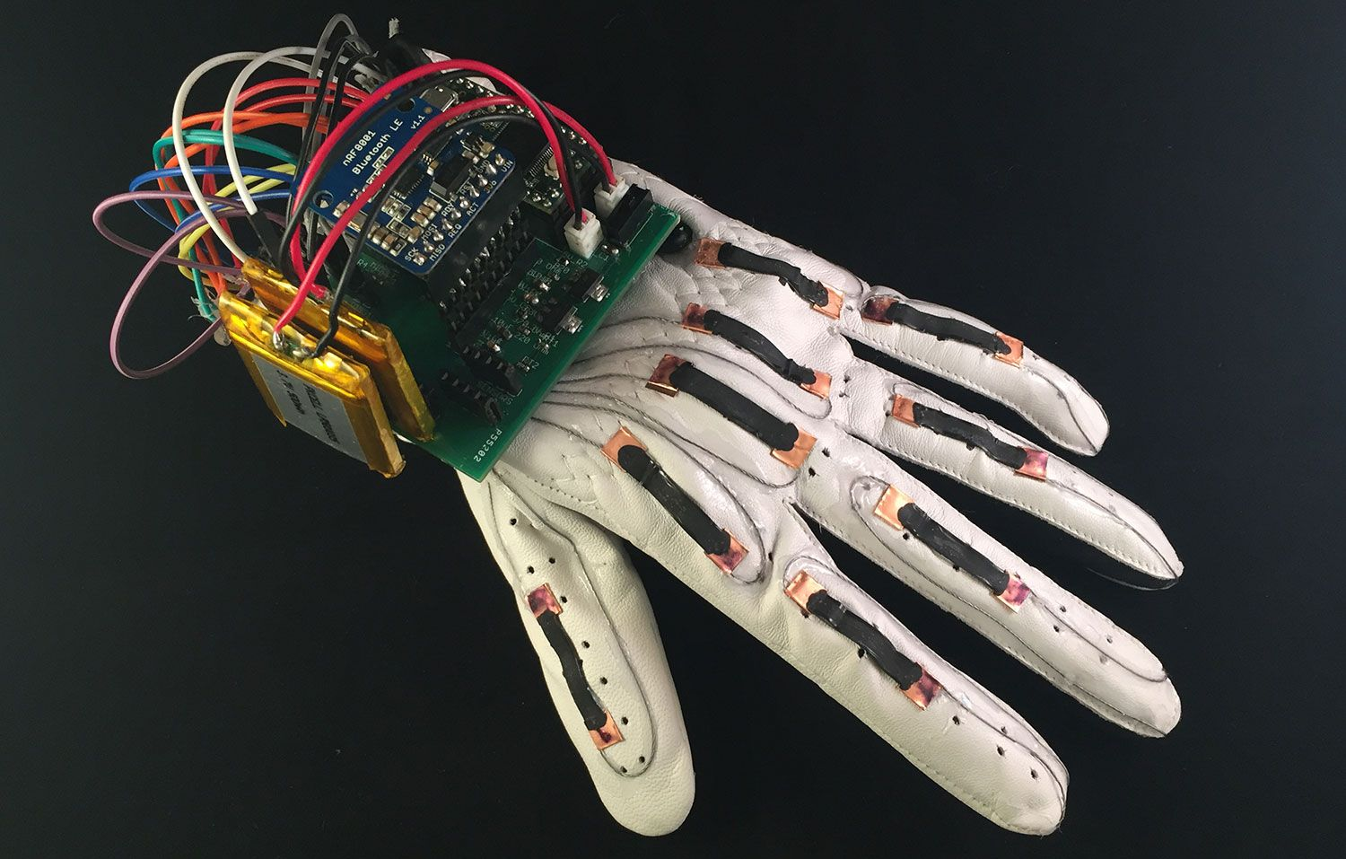Created an inexpensive glove that converts sign language to text