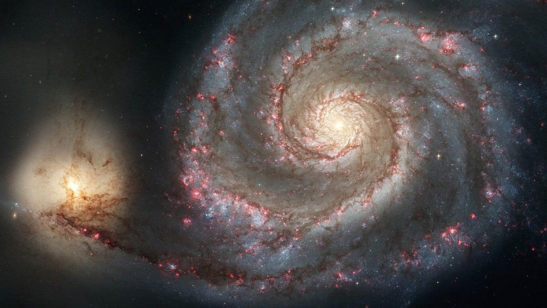 Why are some galaxies spiral shaped?